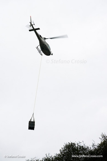 Helicopter carrying Nino Negri's harvested mountain Nebbiolo grapes